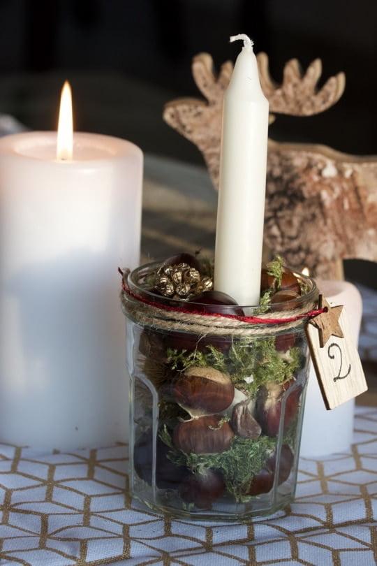 Réaliser un centre de table avec des bougies pour l'Avent.